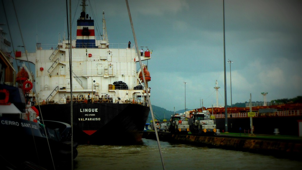 Lining up inside the Panama Canal Locks behind cargo ship transiting the Panama Canal by sailboat